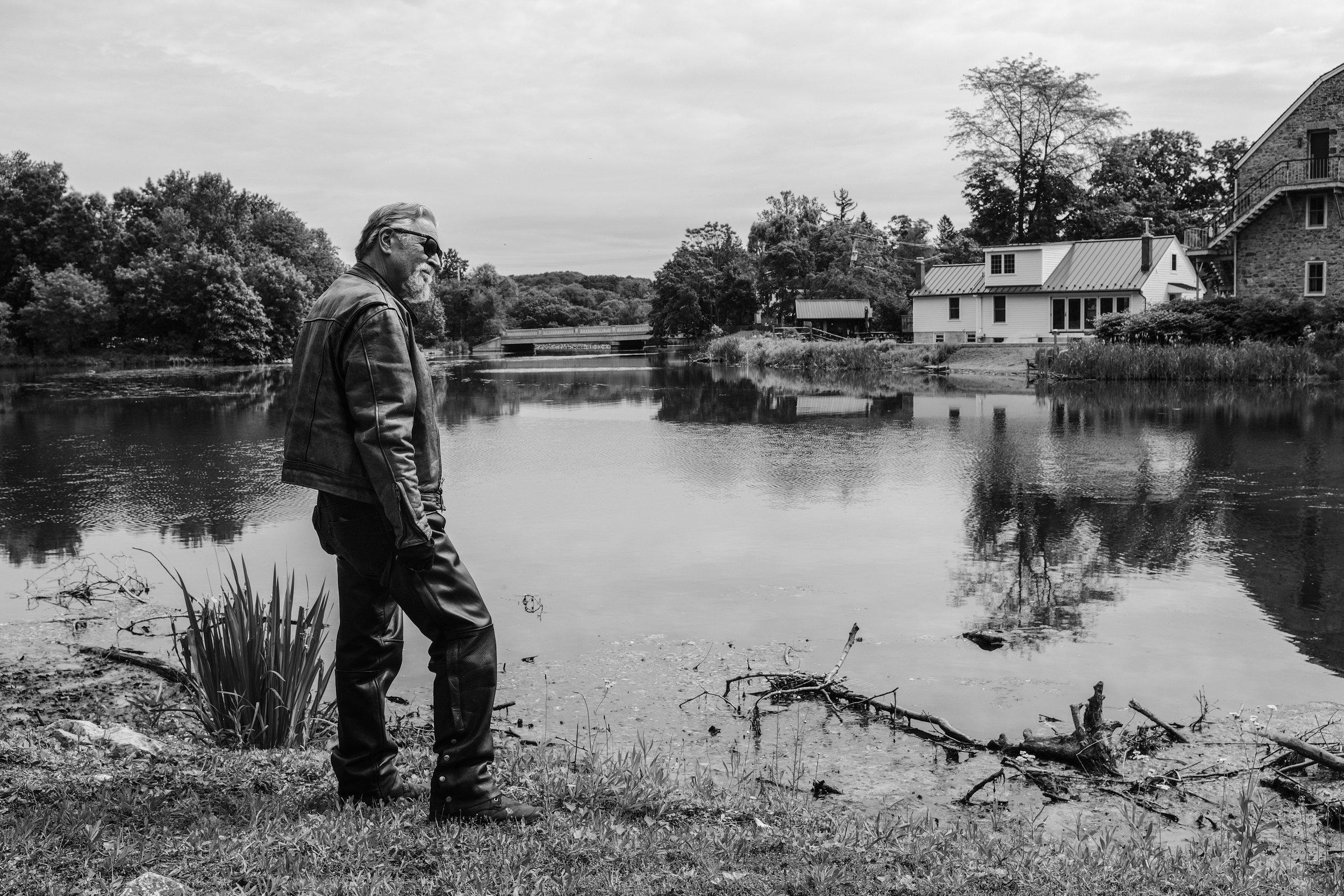 Old biker at the lake