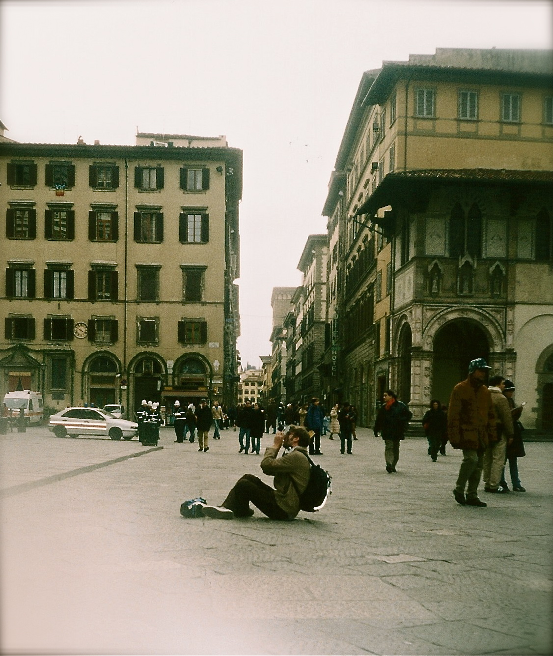 My friend Matt sitting in the middle of a square in Florence, Italy