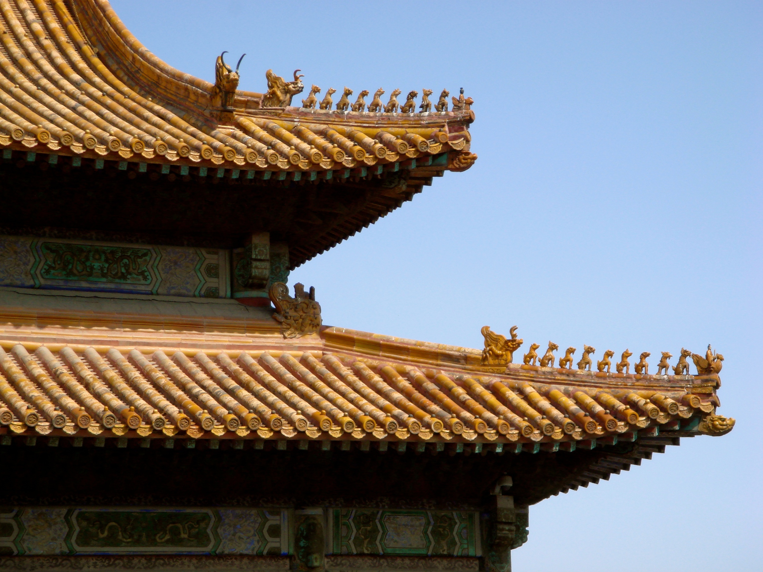 The beautiful golden wing-tipped roof tops at The Forbidden Palace in Beijing, China