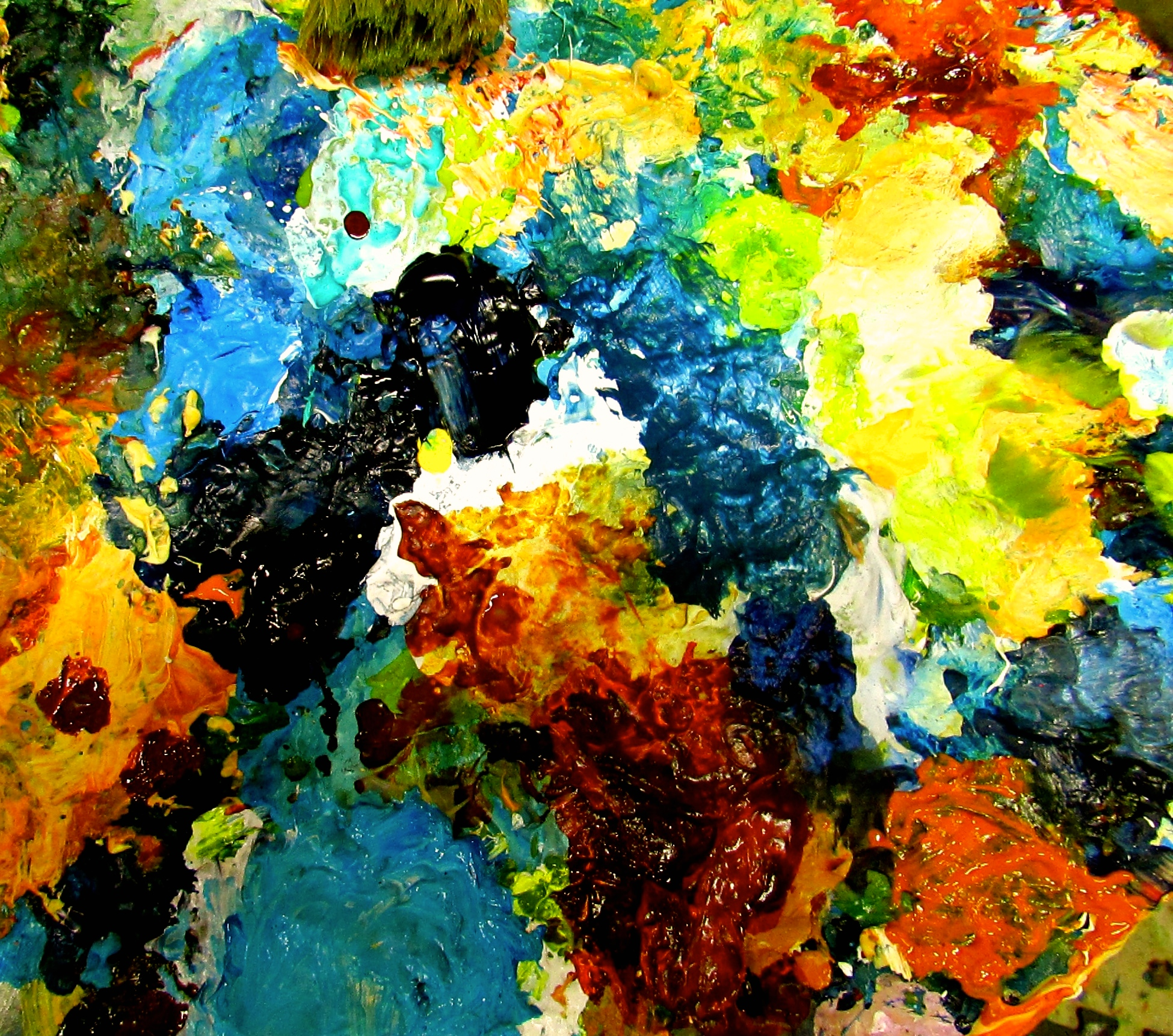 The beautiful swirls and layers of colour on the palette of a working artist