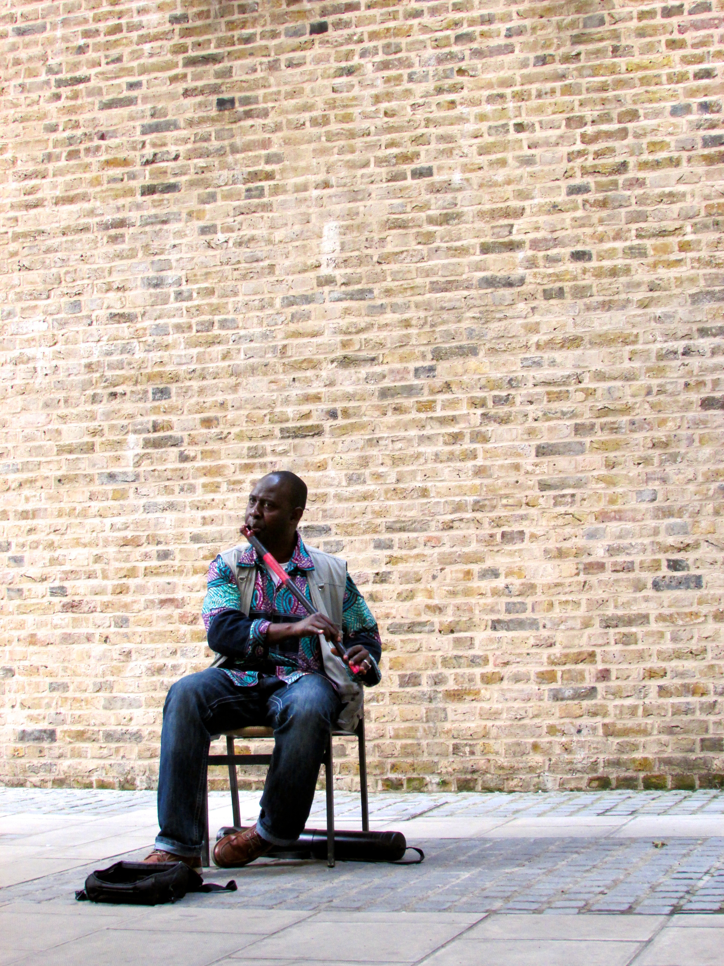 Musician on the south side of the river in London, England