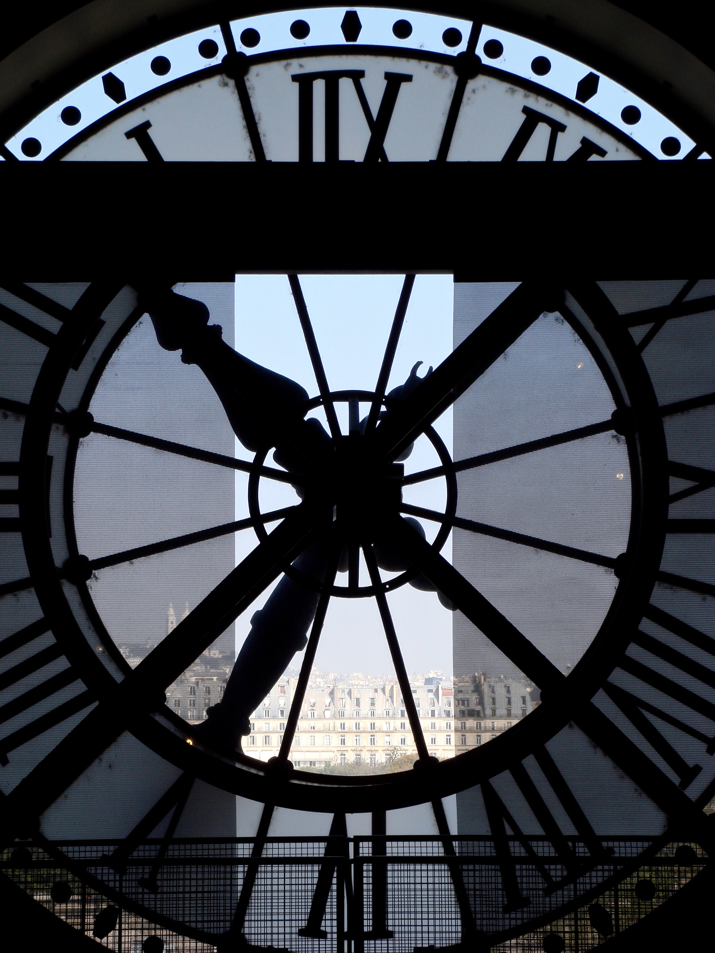 The view through the huge clock at the Musee d'Orsay in Paris, France