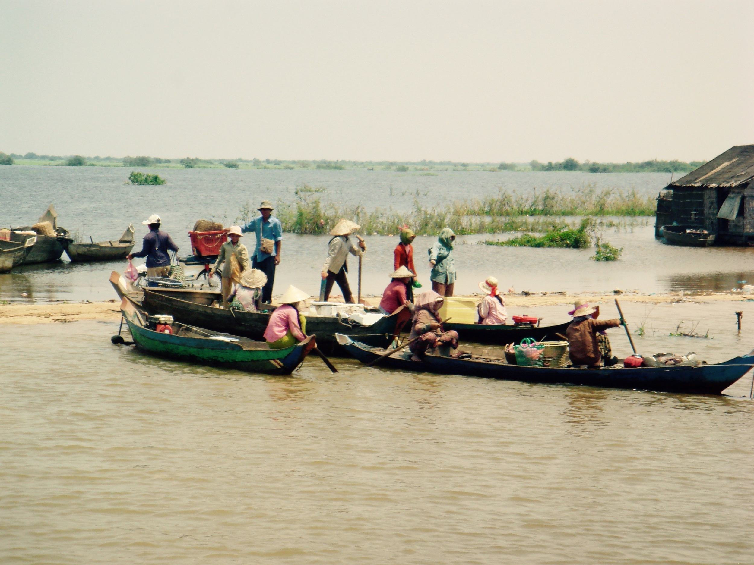 A sandbar in the Mekong River, Cambodia where boats gather around lunchtime