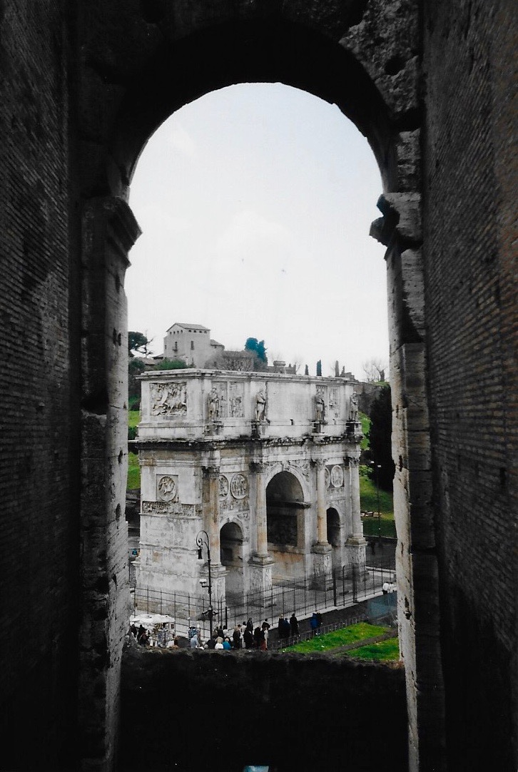 The Arch of Septimius Severus at the edge of the Roman Forum as seen from the interior of the Colosseum in Rome