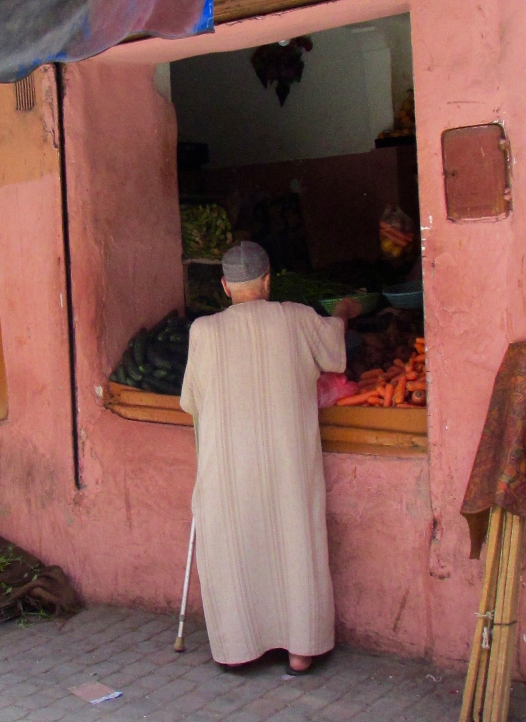 A man buying vegetables for a traditional Ramadan soup that is eaten when the sun sets in Marrakesh, Morocco