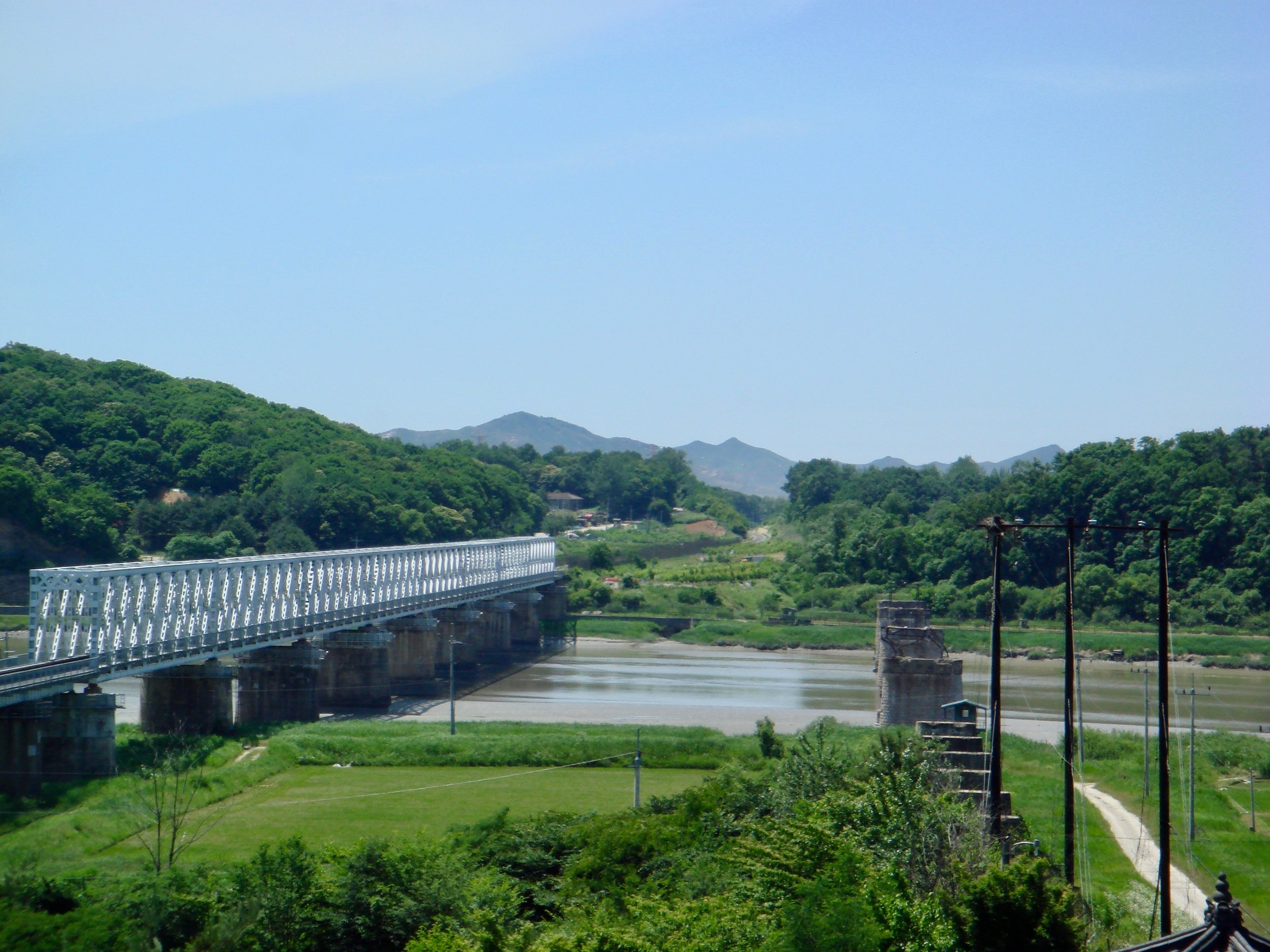 The Freedom Bridge crossing the Imjin River is one of the few physical connections between the two Koreas. The far bank of the river is the North Korean side of the DMZ.