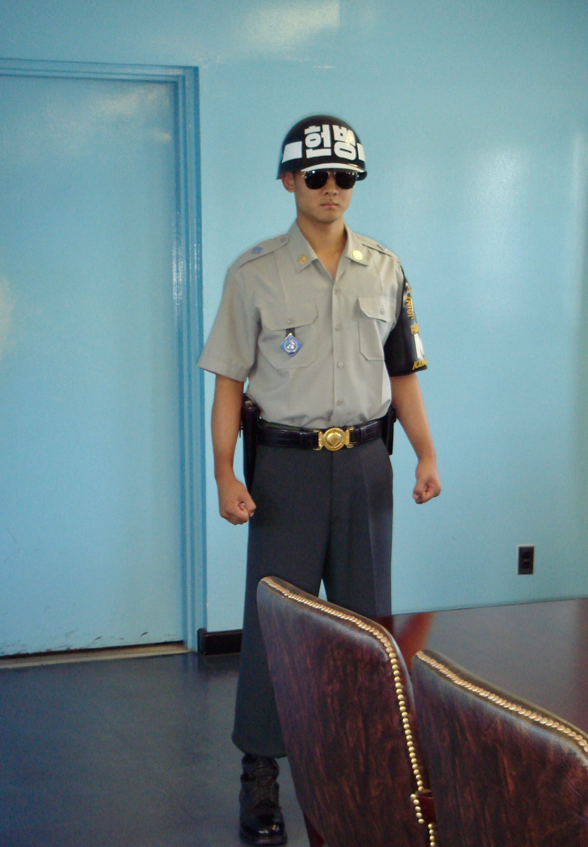 South Korean soldier standing in modified taekwondo stance inside the UN building.