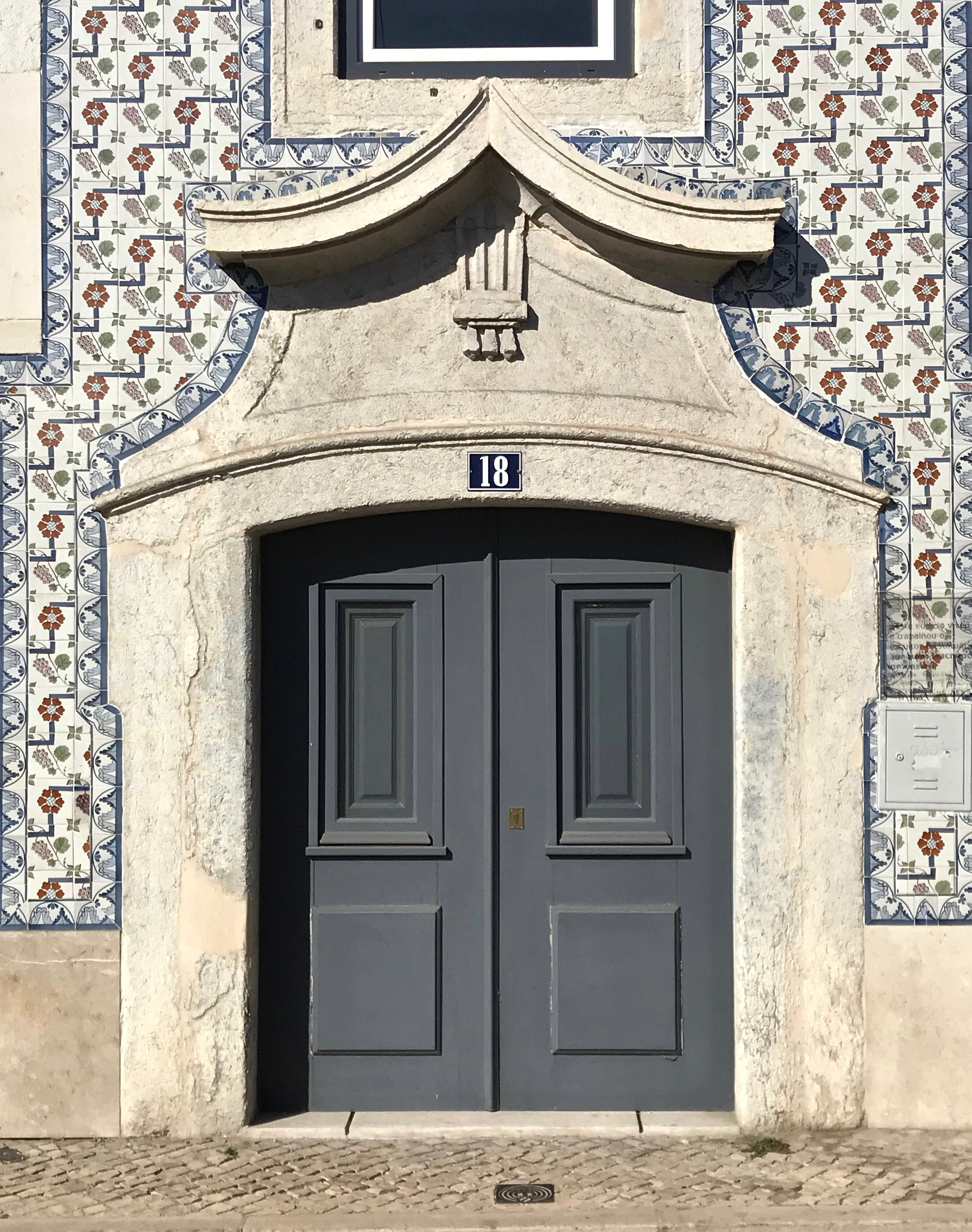 Why are the buildings in Portugal covered in tile?