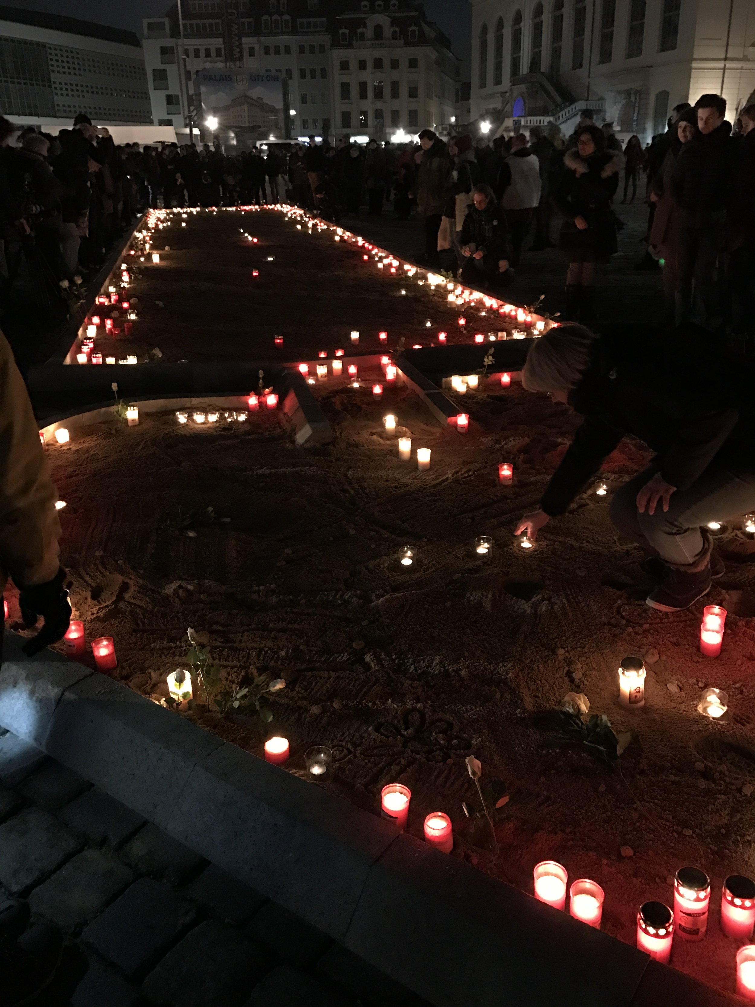 Candles lit in the center of downtown, in the square by the Church of Our Lady.