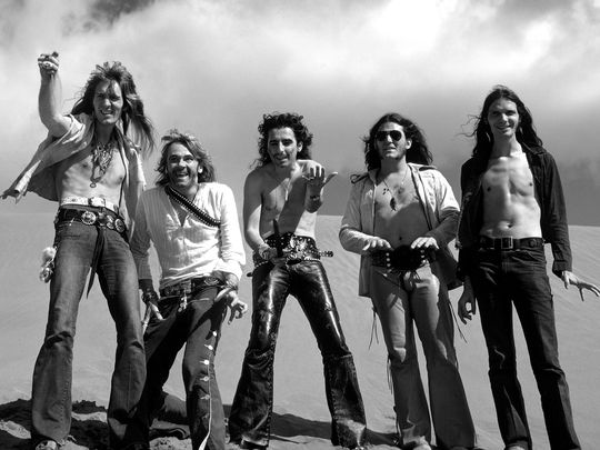 "Pictured are Neal Smith, Glen Buxton, Alice Cooper, Michael Bruce and Dennis Dunaway, the original members of the Alice Cooper group in the early '70s, after writing ""Generation Landslide"" in the Canary Islands. (Photo: Cindy Smith Dunaway)"