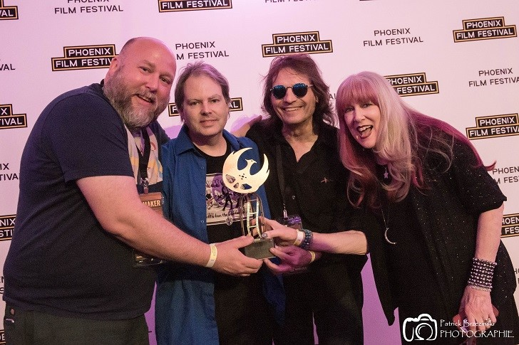 Chris Penn, Steve Gaddis, Dennis Dunaway, and Cindy Dunaway with the Phoenix Film Festival Best Documentary Short award for Live from the Astroturf, Alice Cooper.