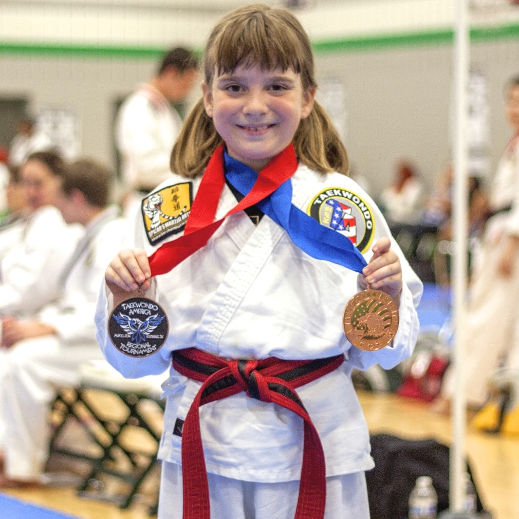 Sydney winning 2 medals at the biggest martial arts tournament ever in Southlake, TX.