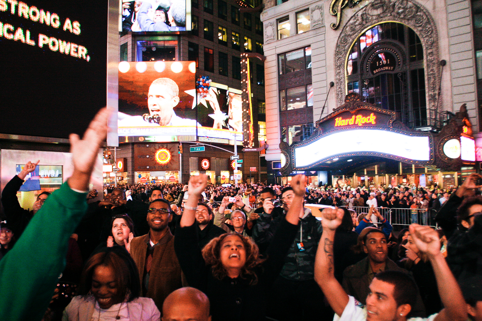 "11/04/08. New York, NY.  Thunderous cheers and shouts of ""Obama!"" rise  from the crowds in Times Square during the historic moment when Senator  Barack Obama is announced as the 44th President of the United States and  first ever African-American to win the election."