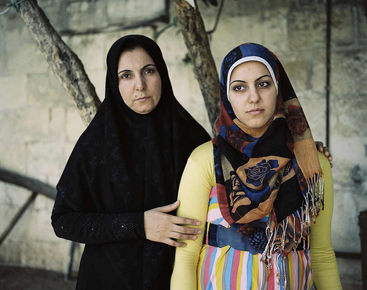 "Ragda (36) and her 7-months pregnant daughter Nora (19) at a shelter for widows in Gaziantep, Turkey. Ragda lost her husband and two sons in a barrel bomb attack in her old neighborhood in Syria. ""We cannot make plans for our future until Syria is whole again."" - Ragda S."