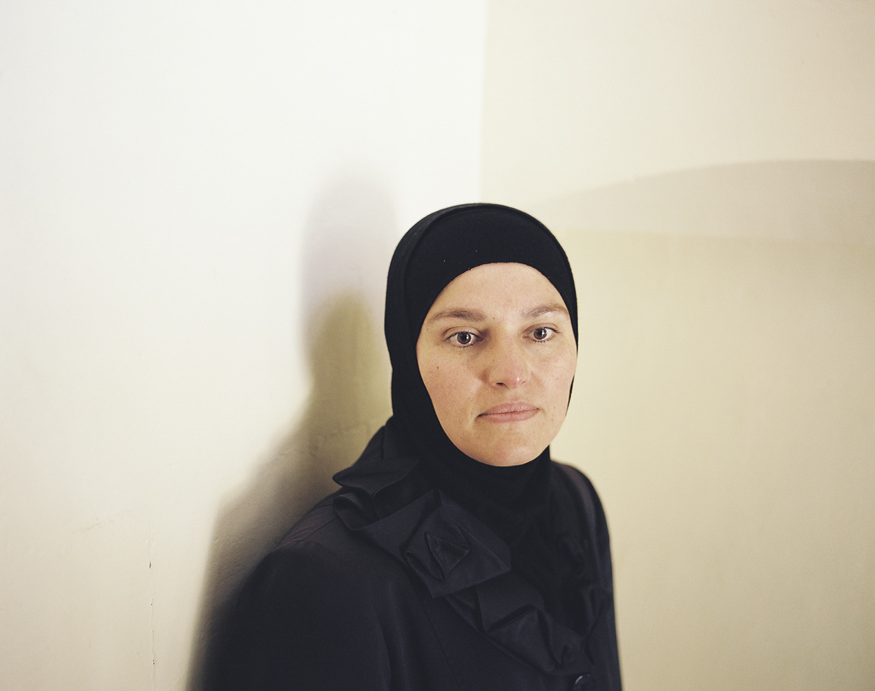 "Ibtesam (40), an english teacher from Aleppo, fled to Kilis seeking medical help after a bomb dropped on her home  killed her 11-year-old daughter Iman and left her other daughter Aya (14) injured with a broken skull and consequently amnesia. ""I lived a normal and simple life in Syria"" says Ibtesam, who was pro-revolution because she wanted a better life for her children. Now, she visits the center for displaced Syrian women in Kilis daily to learn hairdressing, in hopes of finding work to support her family. Ibtesam's name in Arabic means ""smile""."