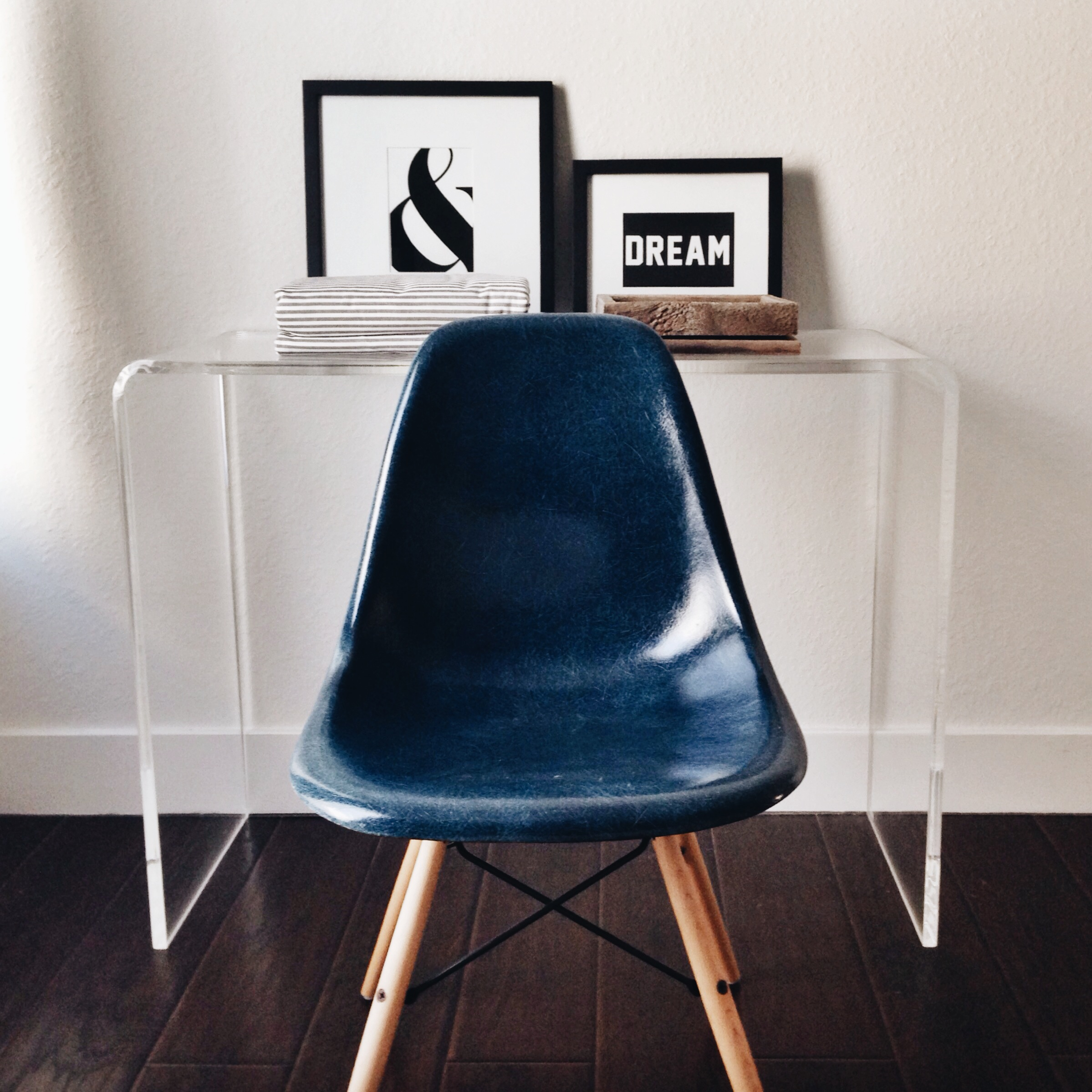 WEST ELM  gallery frames  / HERMAN MILLER  antique Eames chair (via Etsy ) / CB2  clear console table /  RUSTICDECORFRAMES  picture frames (via Etsy)