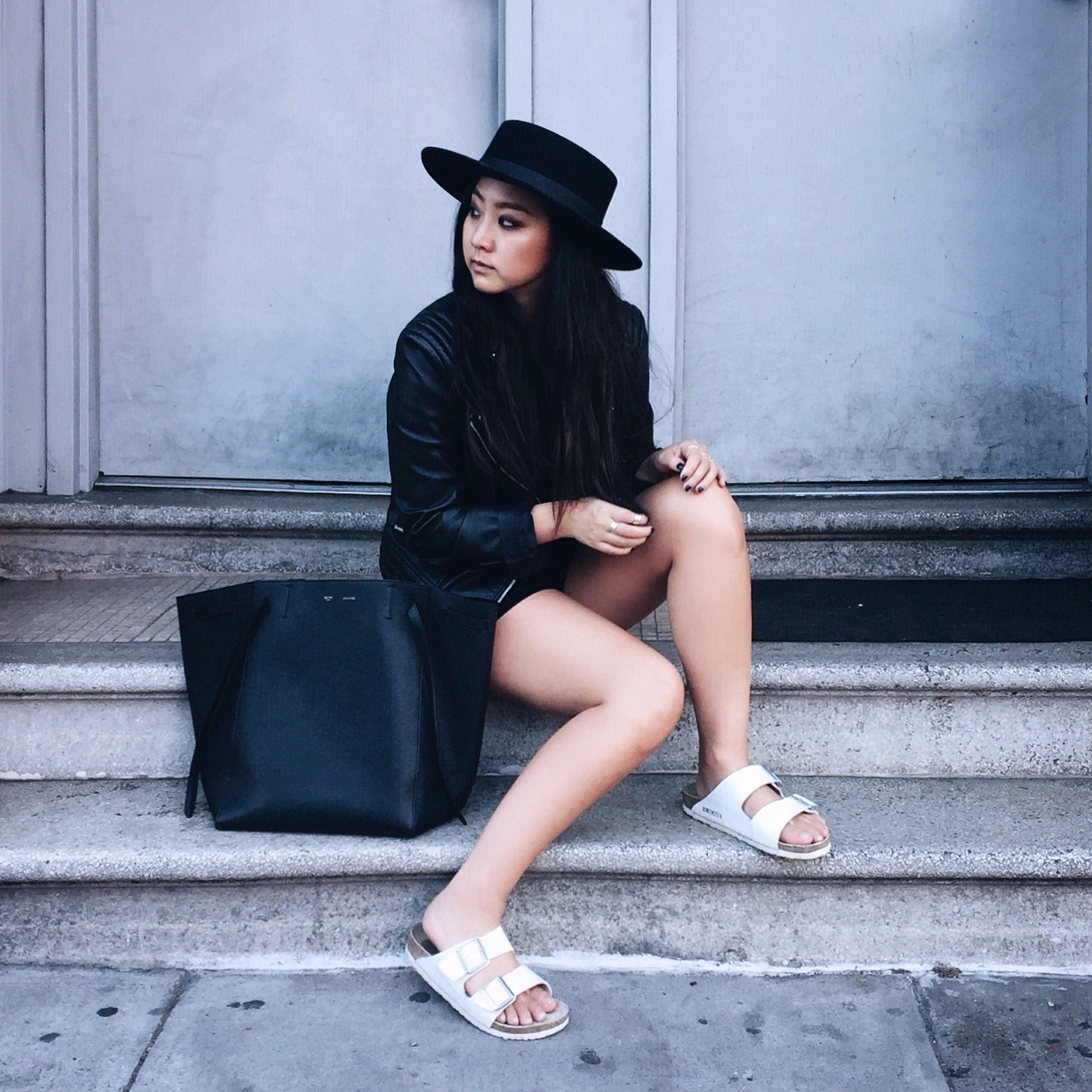 BIRKENSTOCK   sandals   / MANGO  leather jacket   (similar  here )  / MANGO   romper   / CELINE  Phantom   tote /  JANESSA LEONE   Gabrielle hat