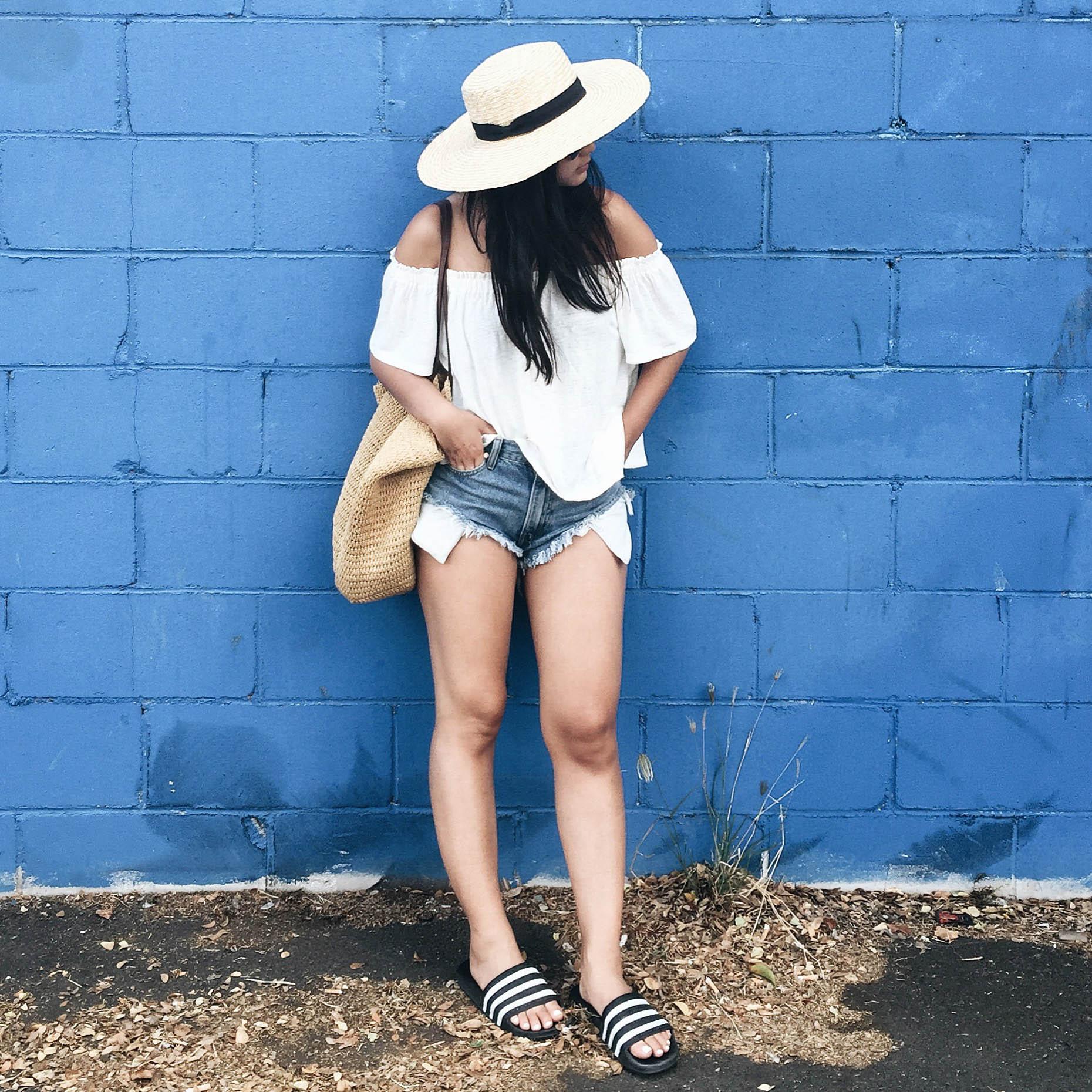 ARITZIA   off-shoulder shirt  / ONE TEASPOON   cut-offs  / ADIDAS   slides  / FREE PEOPLE   hat   / J.CREW   tote