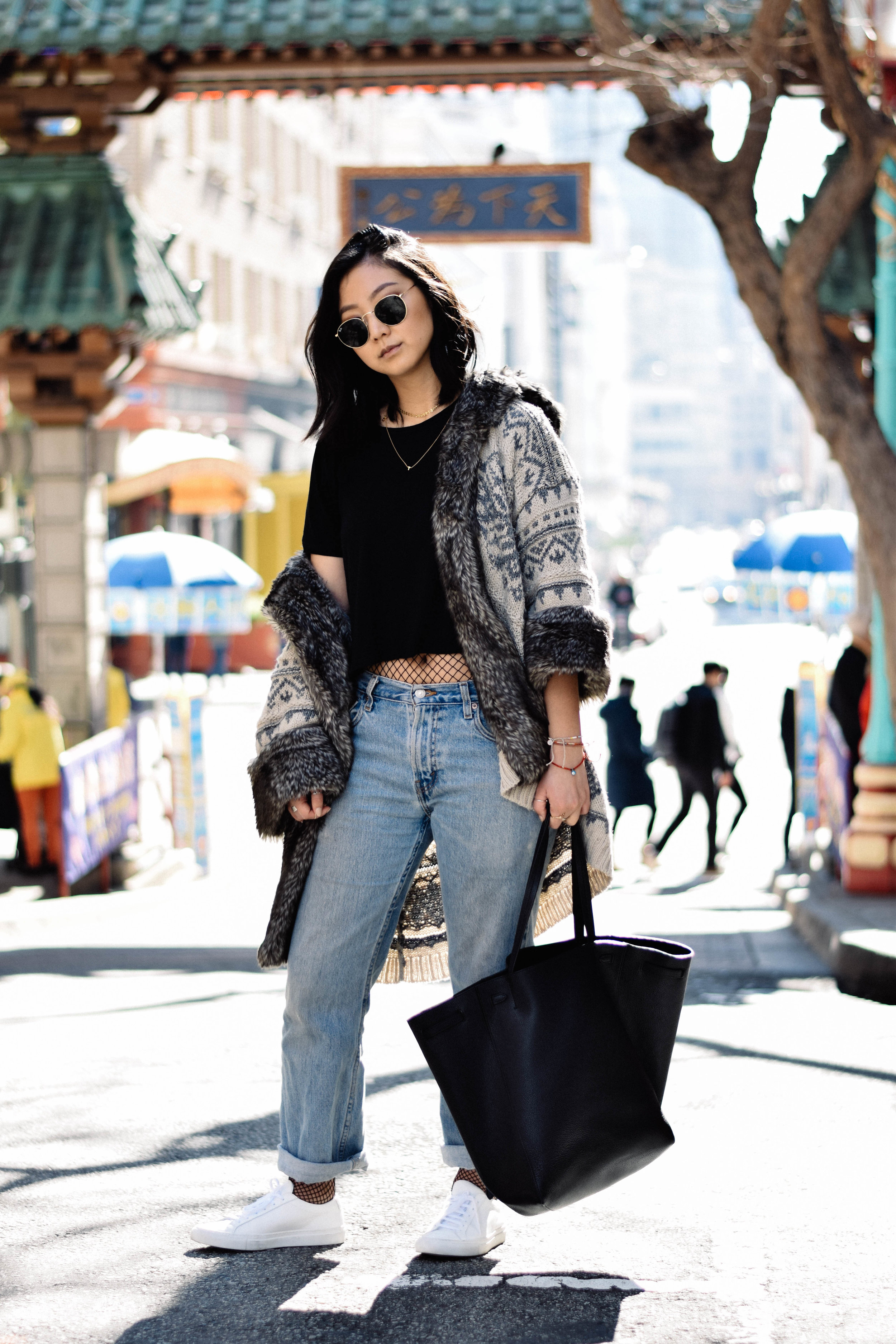 ZARA  sweater / ZARA  crop tee  / ASOS  fishnet stockings / LEVI's   jeans   / COMMON PROJECTS  sneakers  / CELINE  cabas tote  / RAY-BAN   retro-round sunglasses