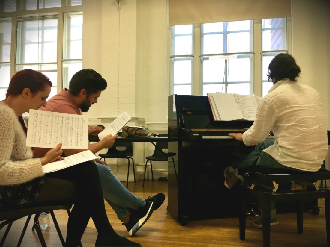 Alex the composer and two of our actors, Suzanna and Joseph, working on the songs