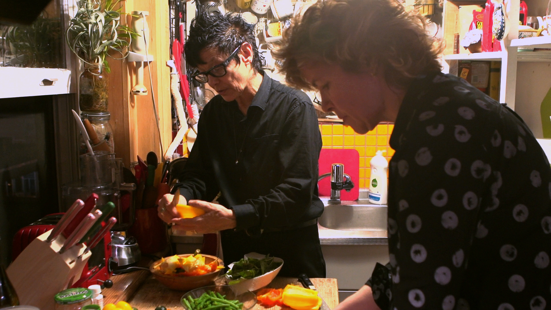 Elizabeth Streb and her partner Laura cooking in their Soho Loft.
