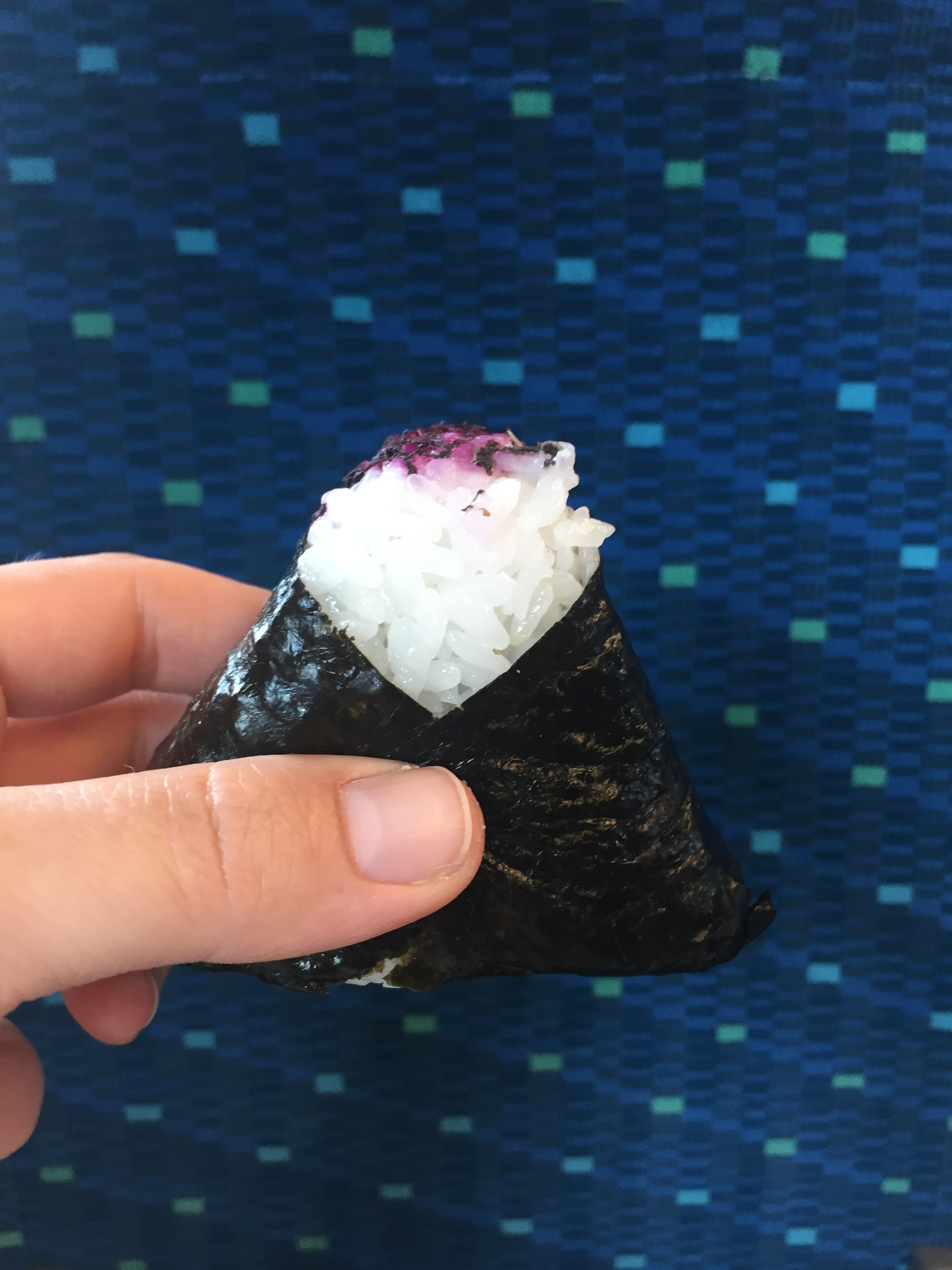 A pickled plum onigiri on my last Shinkansen ride!