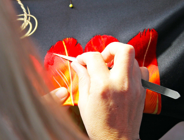 Hand flocking the finished scarves!