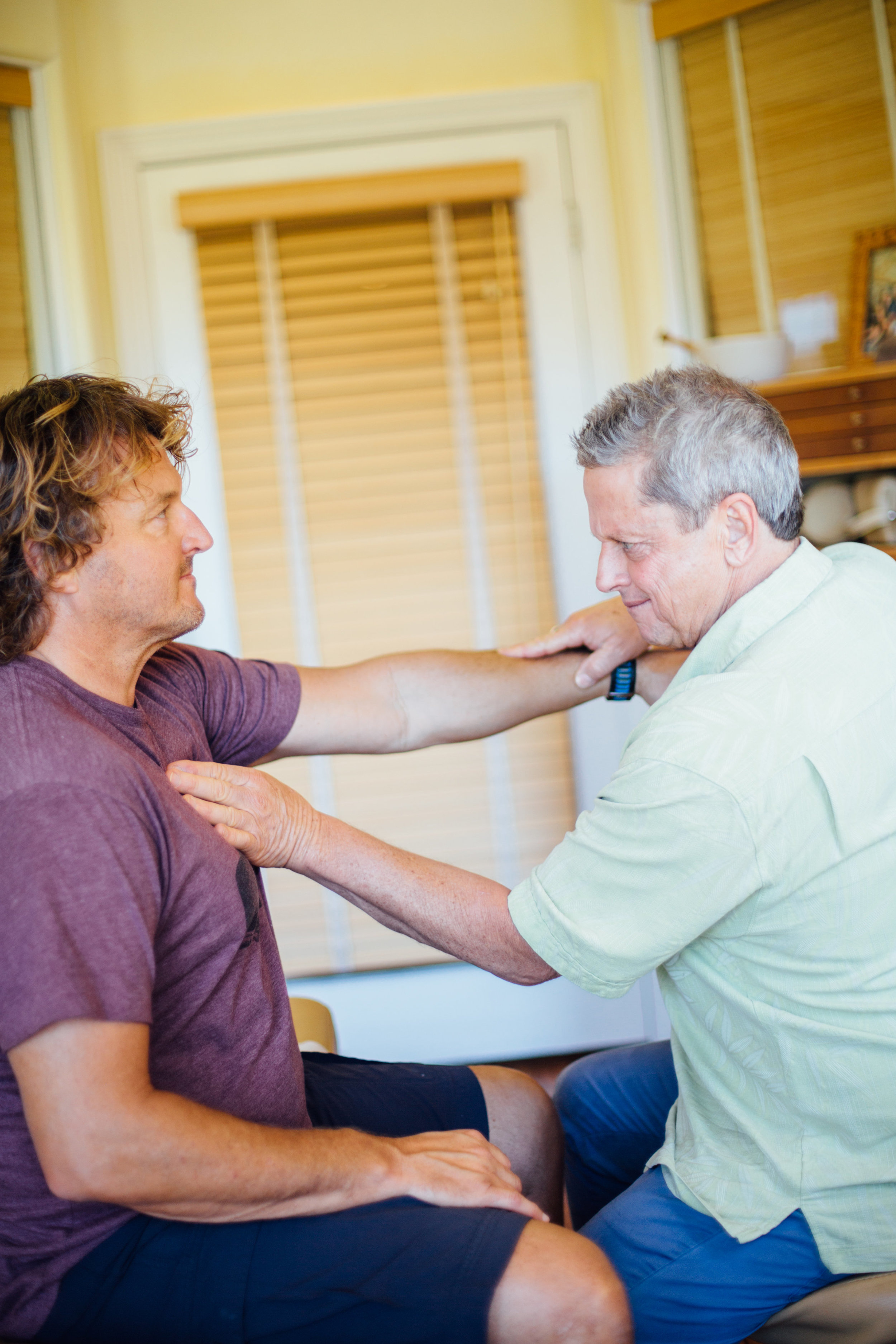 Dr. G and Tom- muscle testing.jpg