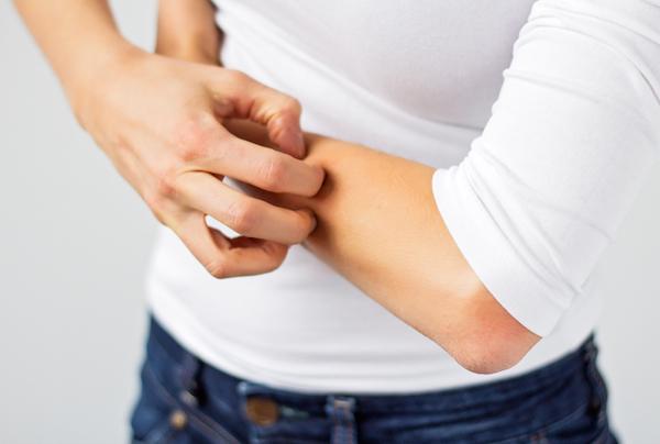 skin disorder-girl scratching skin.jpg