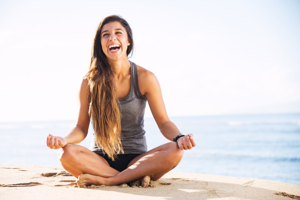 Yoga girl on beach laughing.jpg