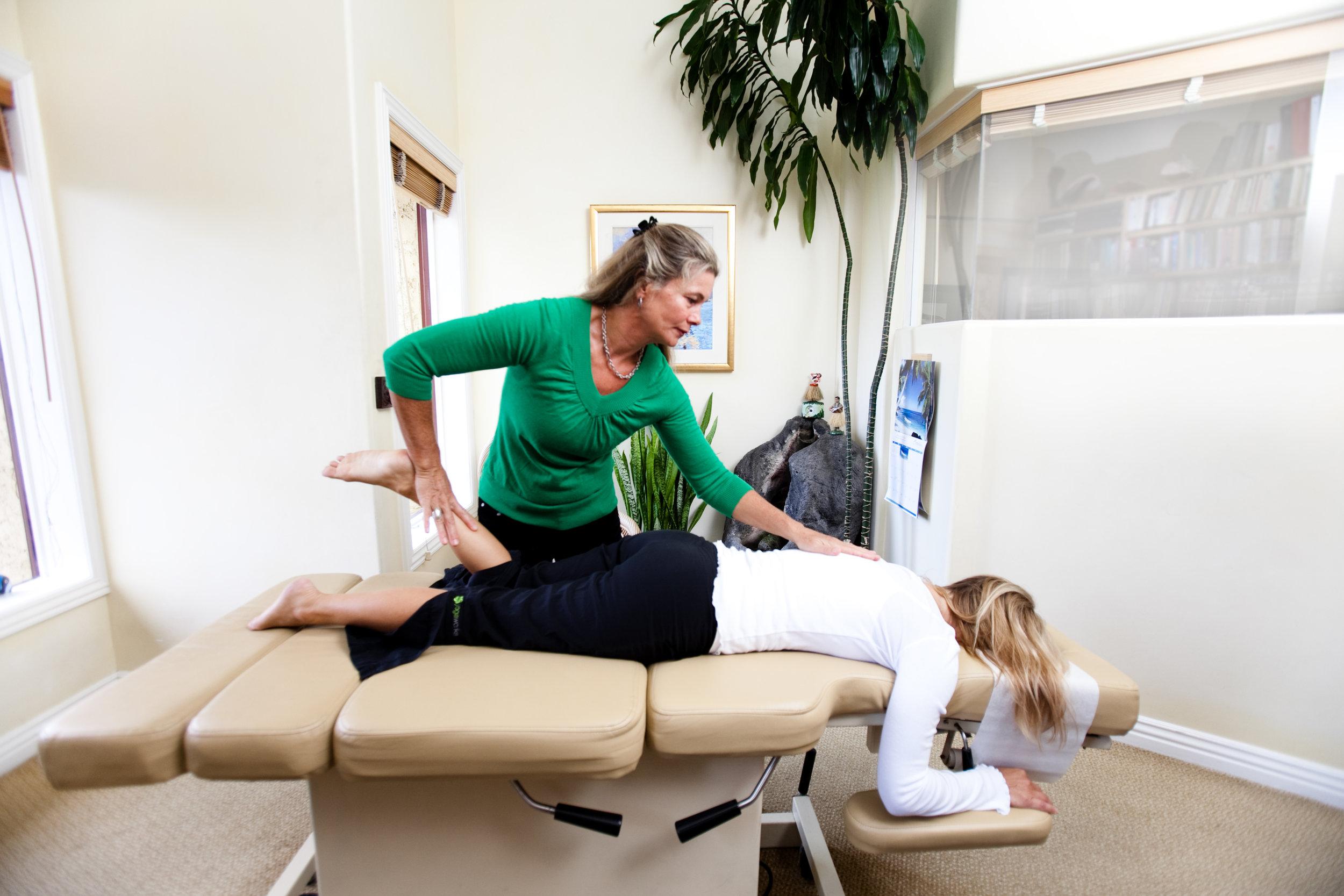 Dr. Lisa Woman Patient, ankle muscle test.jpg