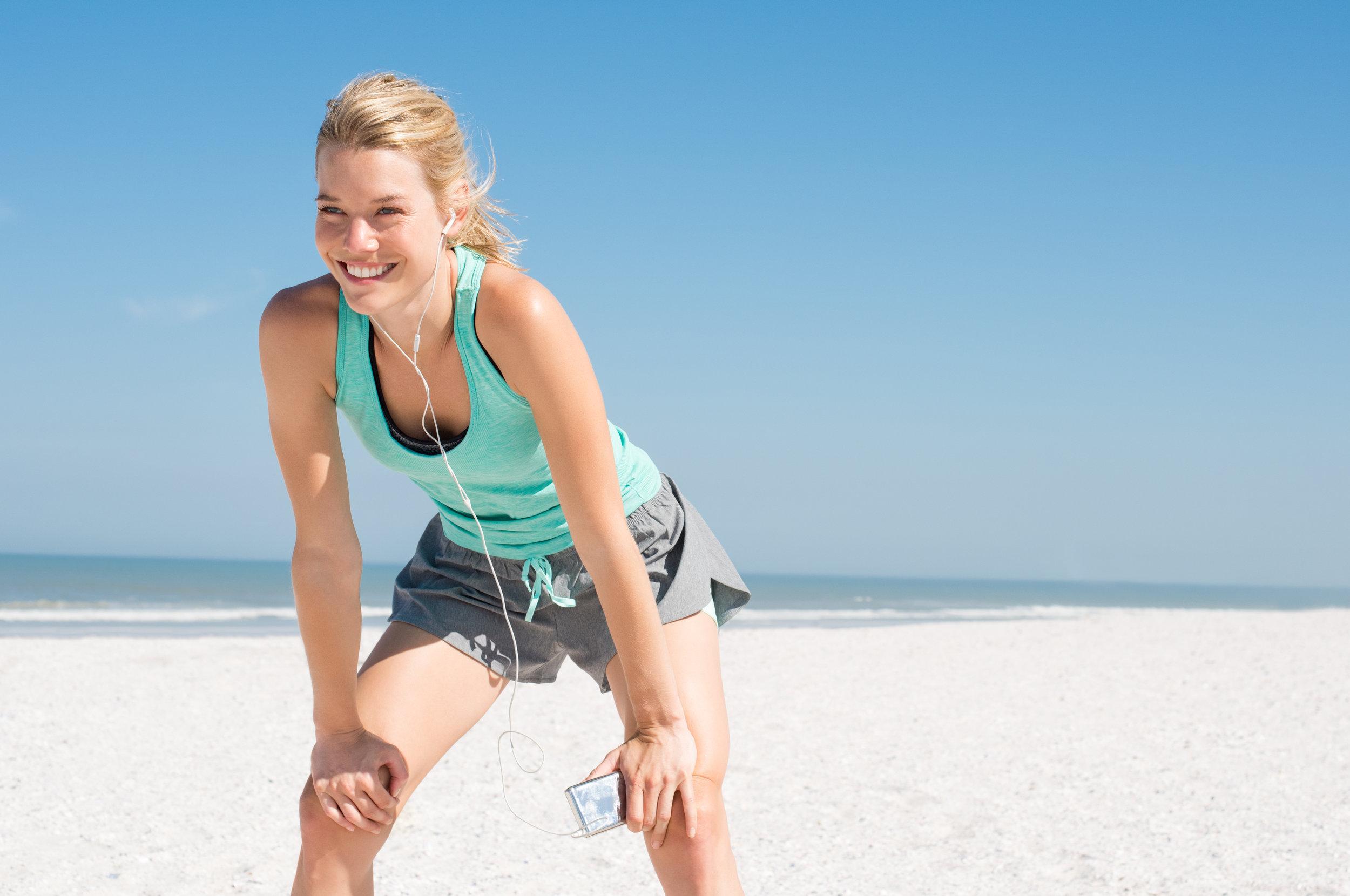iStock- woman exercising on beach.jpg