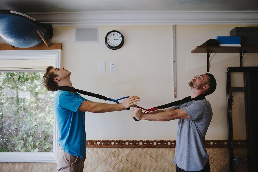 Noah and Logan- Prolordotic 3 GOOD necks back.jpg