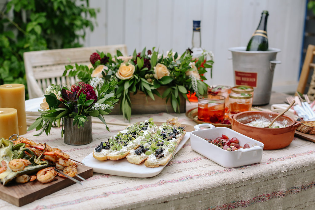 Menu: Food: Cheesy Poblano Chiles stuffed with Grilled Shrimp, Blueberry Gorgonzola Ficelle Sandwiches, Ricotta with olive oil and Thyme, Roasted Red Grapes served with Grilled Levain Drinks: Sparkling Wine and Aperol Spritz