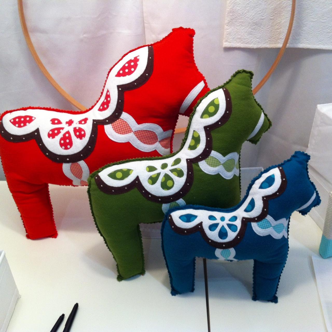 "These pillows are the ""Dala Horse"" pattern by Skipstone Creative. www.skipstonecreative.com"