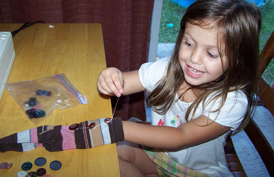 This is my Chloe sewing buttons on socks years ago!