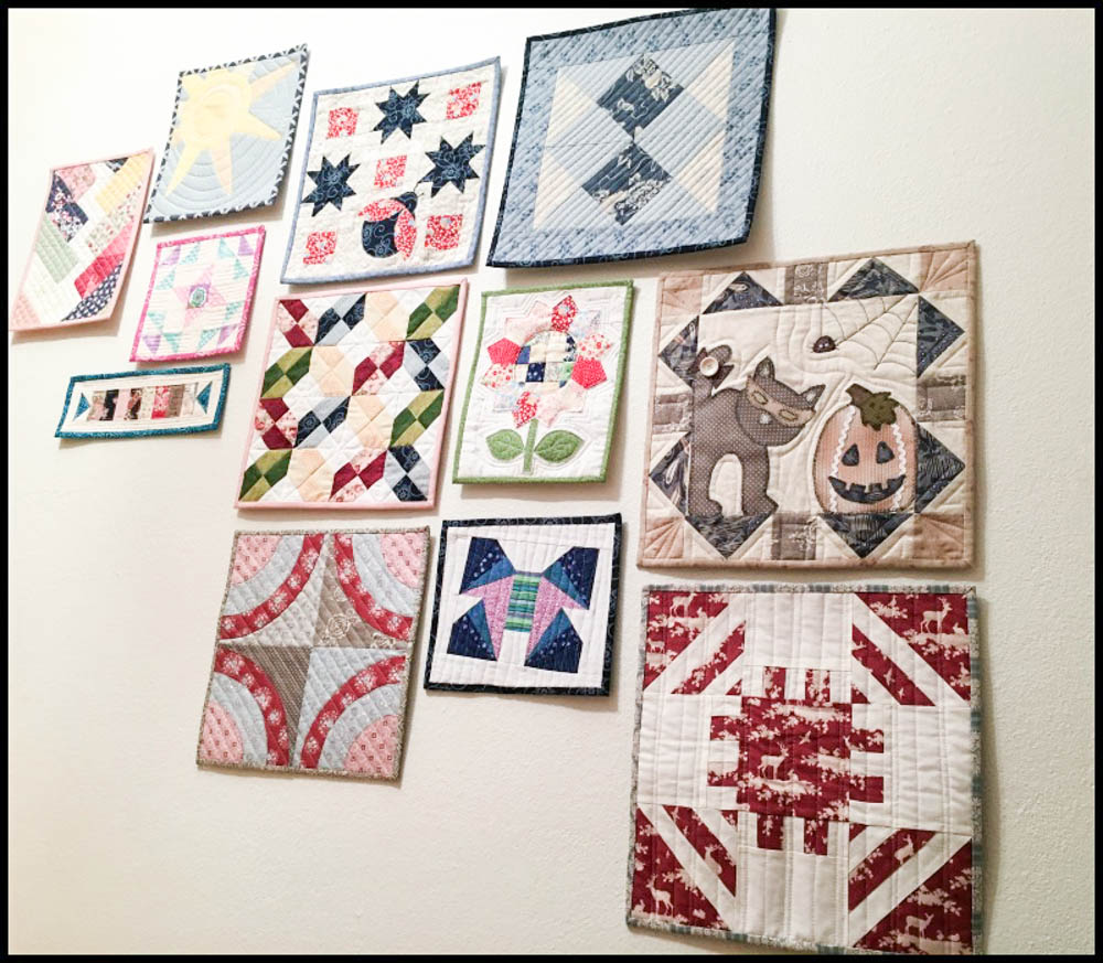 Birthe of Norway sent me this photo of her mini quilt wall that goes up the stairs!