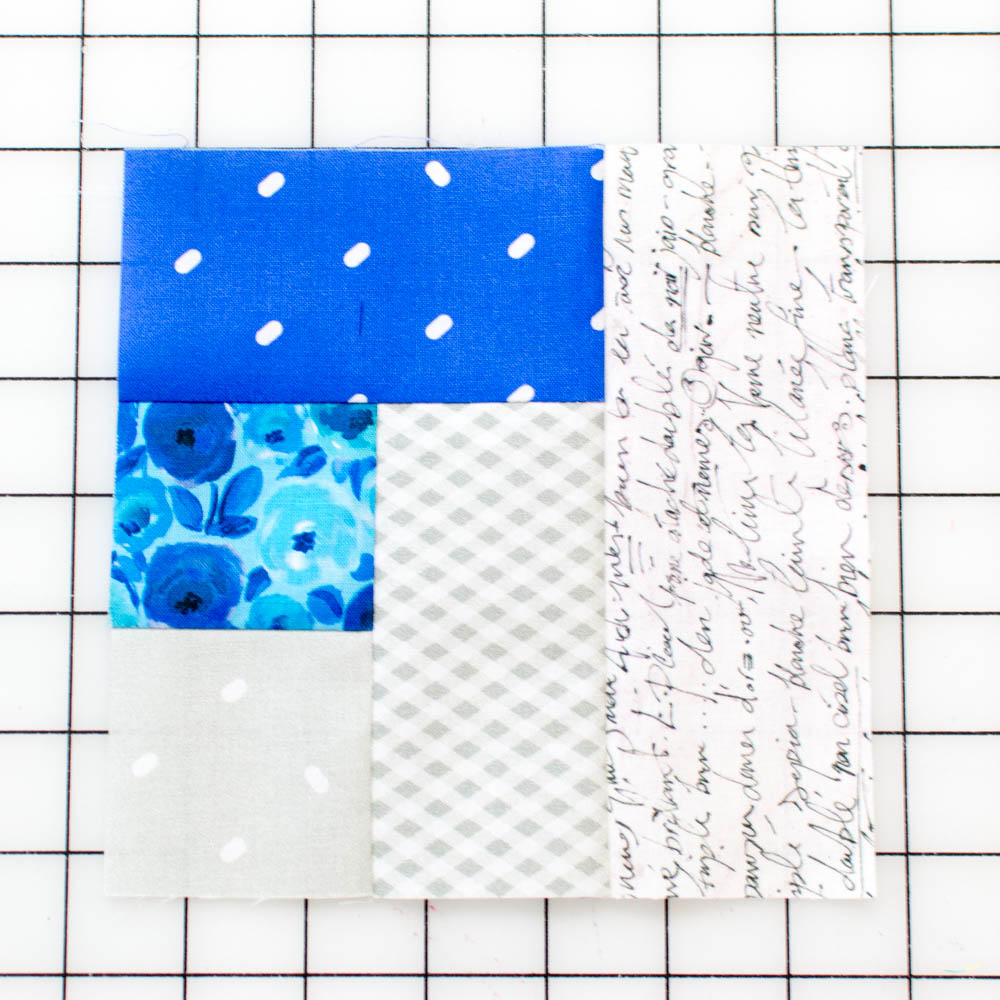 Quilt block unit with fabric 5 added.