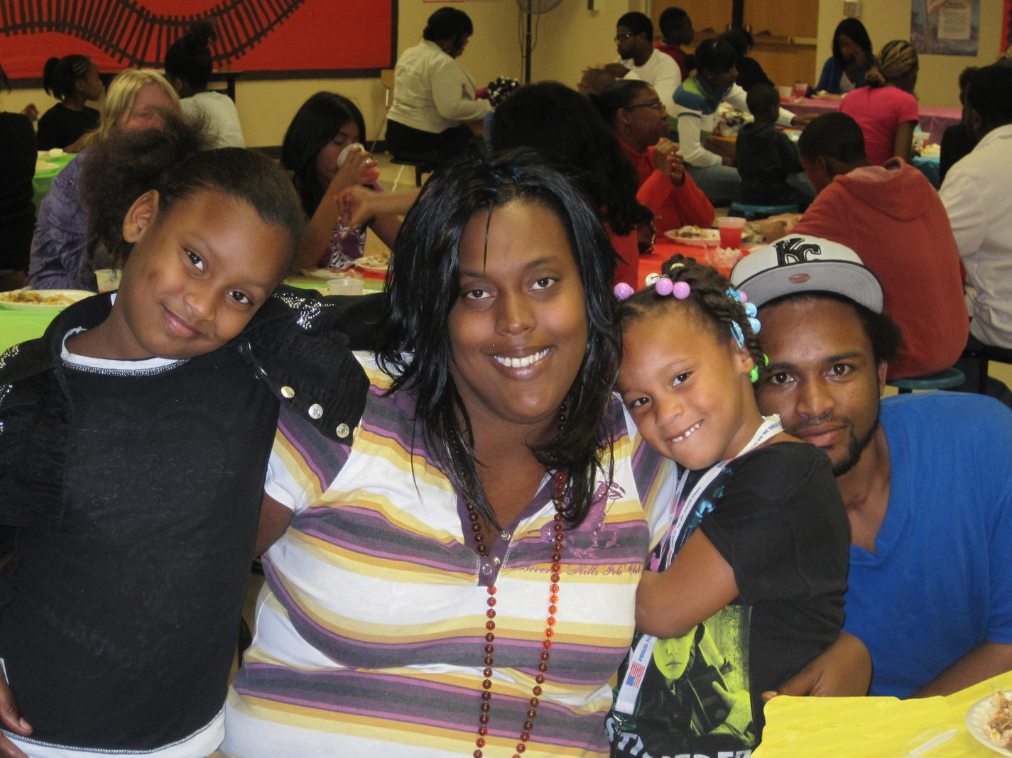 A family at Center Elementary celebrates Lights On Afterschool.