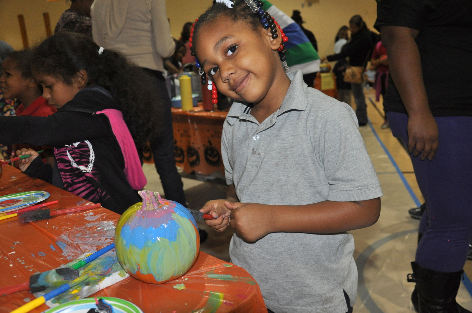 A student at Foreign Language Academy decorates her pumpkin at the 2012 Lights On Afterschool celebration.