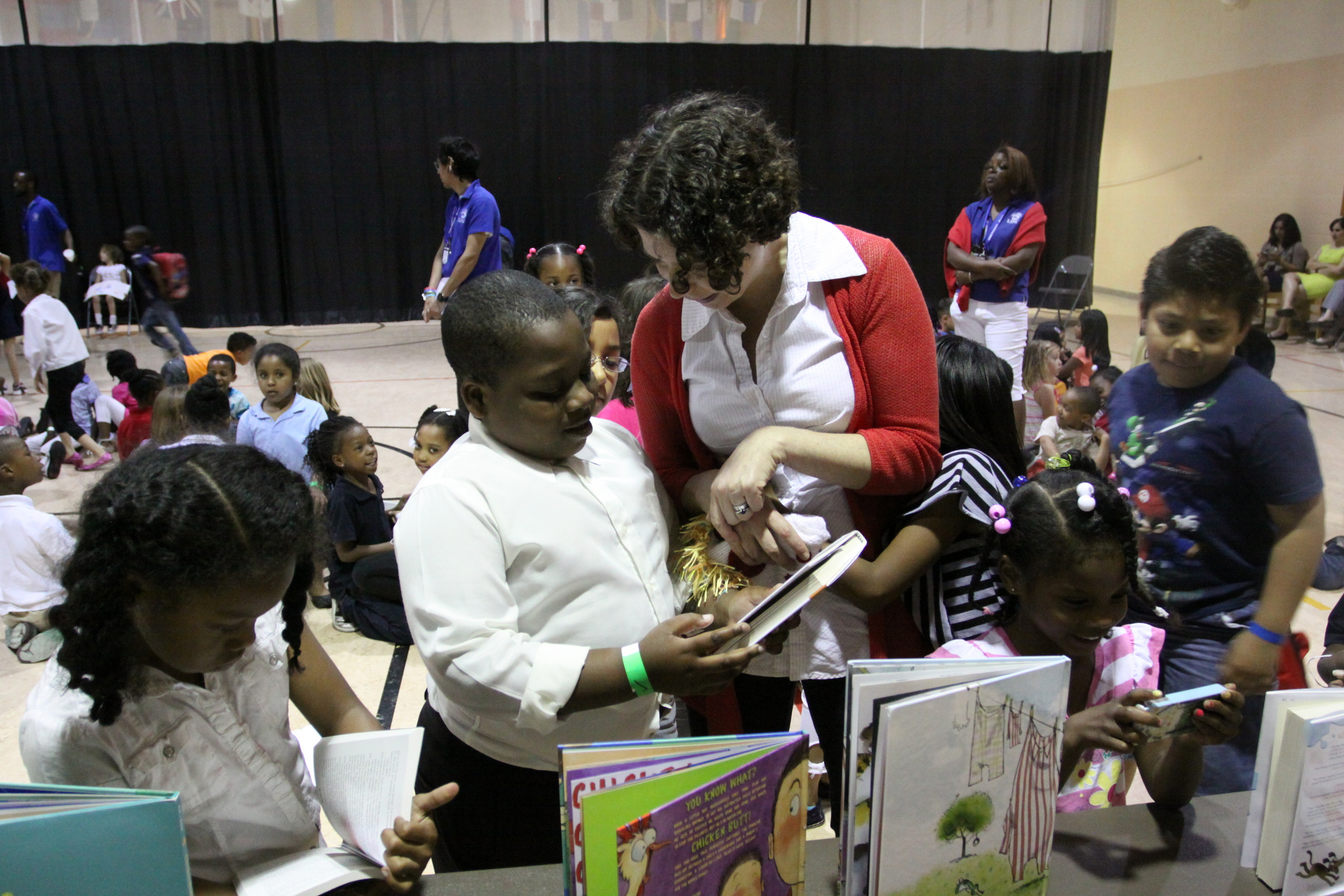 Author Erica Perl talks with and signs autographs for students at Foreign Language Academy in the KCPS