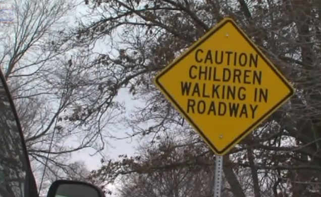 Lack of sidewalks forces Maplewood Elementary students to walk on roads to and from school. Image taken from Fox 4 News video.