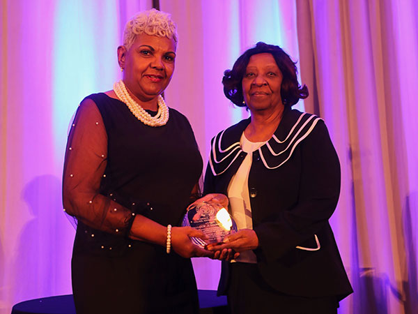 Dr. Marjorie Williams (left) was presented the Carl R. Johnson Humanitarian Award by Barbara Davis, NAACP committee chair.