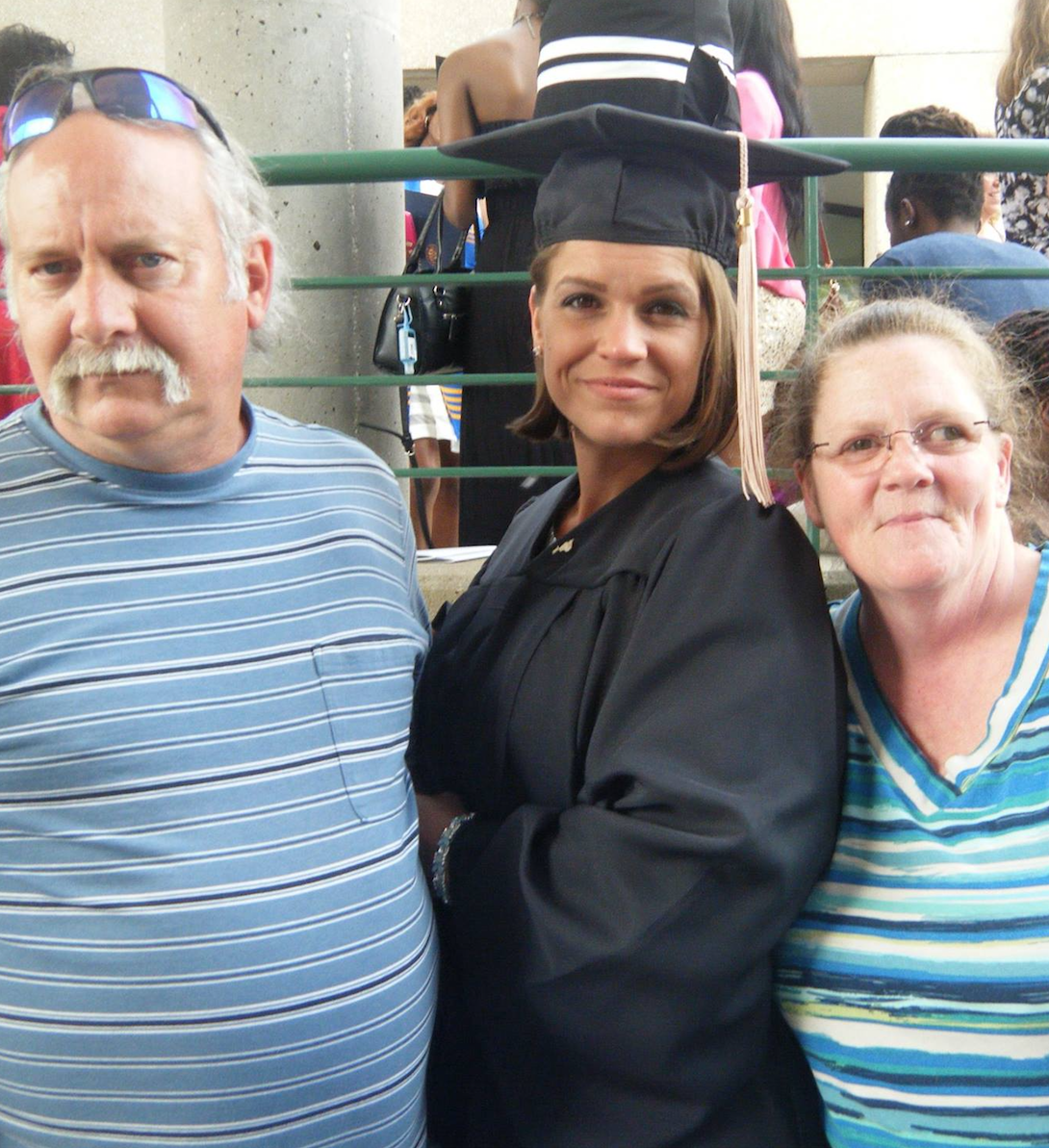 Brandi Wheeler poses with her father and stepmother at her graduation from UMKC in May 2015.