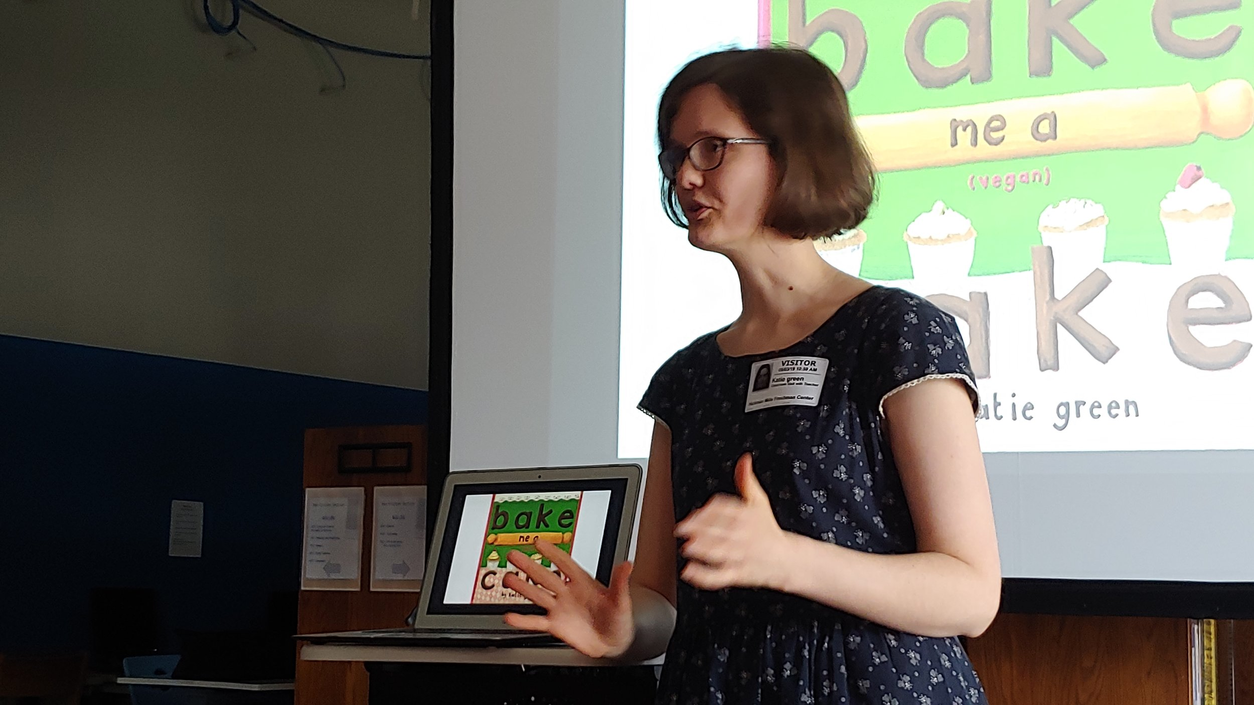 Author, illustrator, designer and podcaster Katie Green from the United Kingdom speaks to students at the Hickman Mills School District Freshman Center.