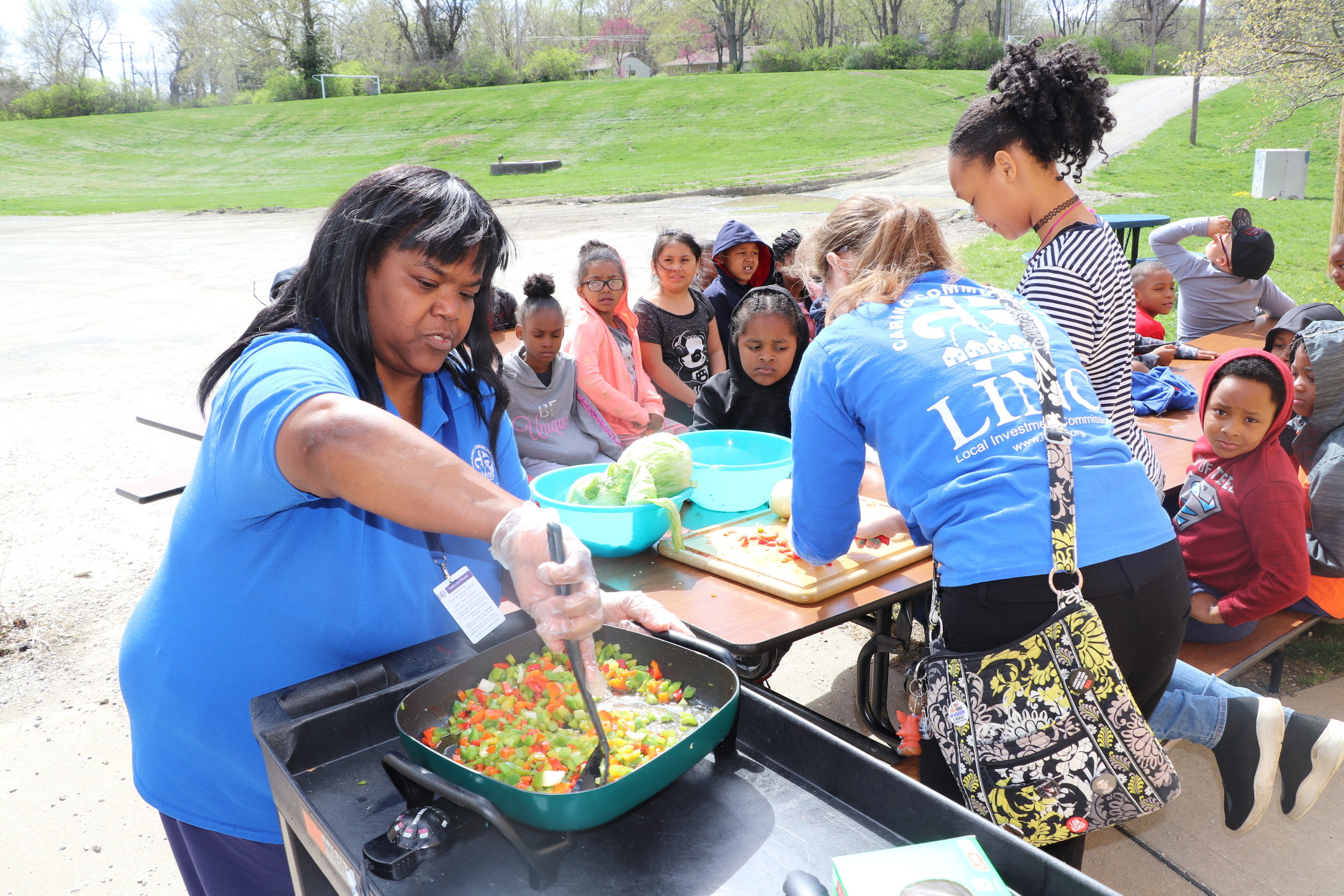 LINC Staff at Johnson Elementary prepare a healthy snack using vegetables from the school garden.