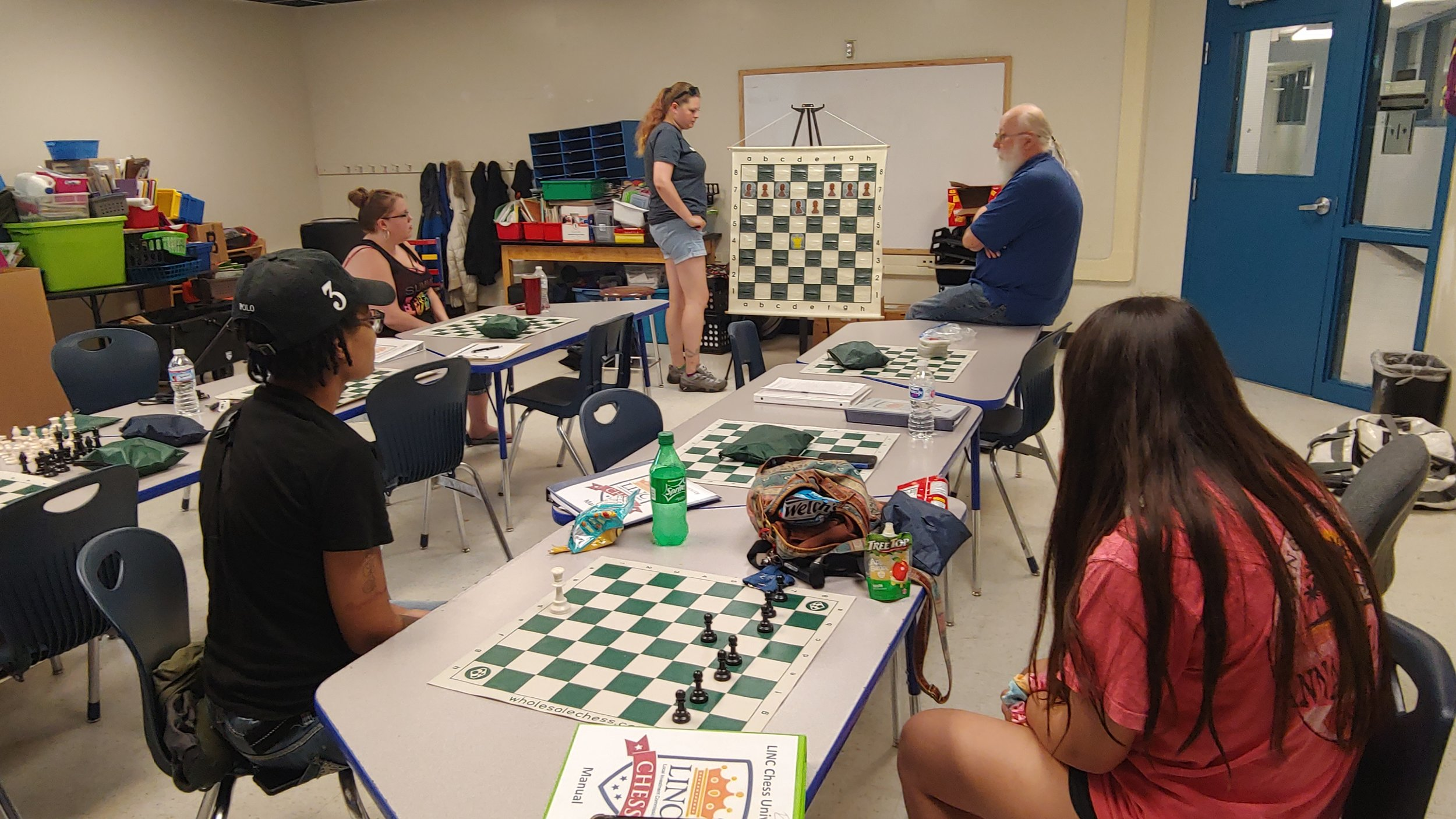 LINC staff and parents at LINC's Chess University learn strategies to teach the game to students July 17 at Genesis School.
