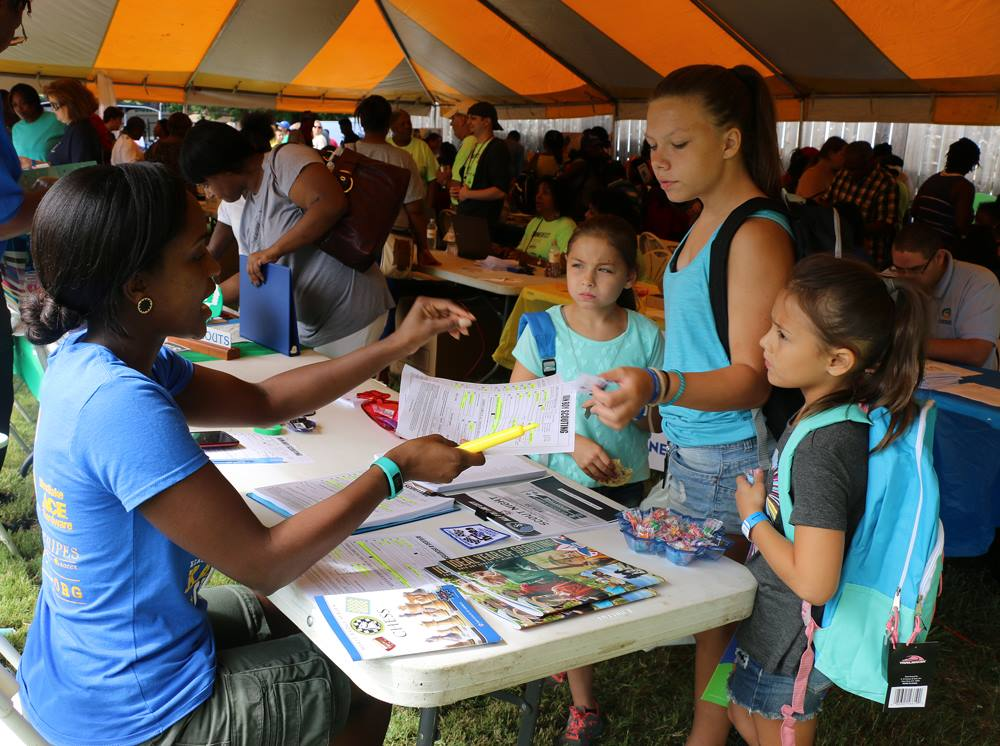 Summerfest, the Kansas City Public Schools enrollment fair, returns August 3 to kick off the 2019-2020 school year with games and giveaways. Above, students receive games and information at the 2016 Summerfest.  Photo by Kansas City Public Schools.