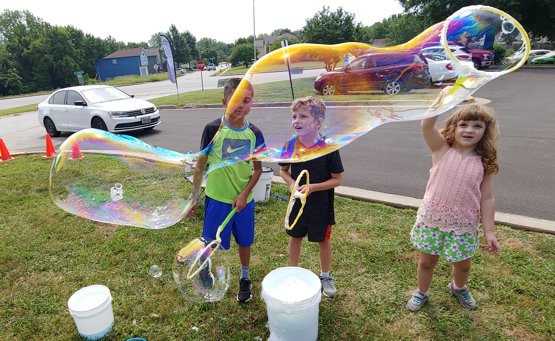 Children create giant bubbles Aug. 17 at a community block party celebrating the opening of the Farview Neighborhood Library and food pantry in Independence.
