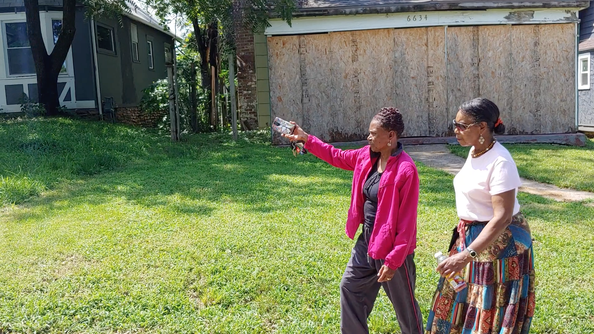 NUFA neighborhood residents Nina Whiteside-McCord and Dorothy Thurman take stock of restoration efforts under way in the 6600 block of Broadmoor Road in Kansas City.